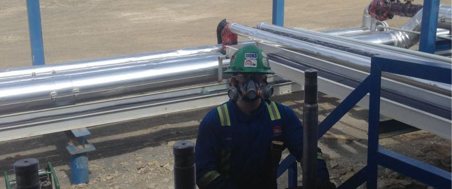 Worker on the oilfield with ventilation mask on